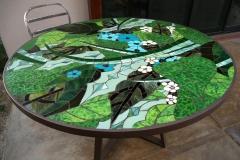 "Going Green, 2017 – glass on glass tabletop in custom steel base – 54"""